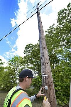 inspecting utility poles
