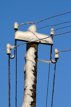 utility_poles_ice_and_snow