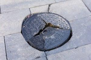 damaged manhole