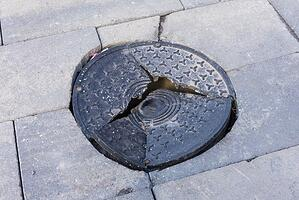 damaged manhole