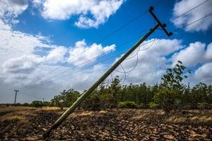 fallen utility pole from fire